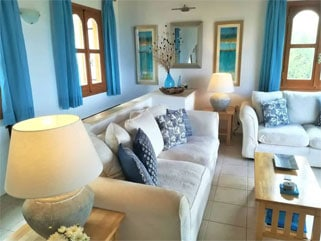 Light airy lounge with big comfortable sofas, beautifully furnished and with TV and sound system.